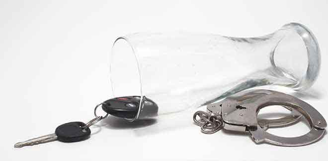 empty-beer-glass-car-keys-handcuffs- dwai colorado springs denver dui lawyer