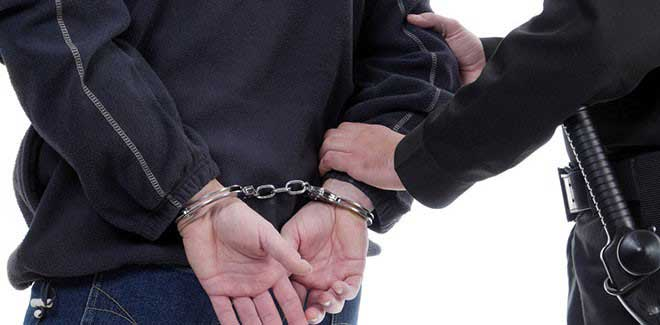 police-officer-arresting-man-handcuffs-needs criminal defense attorney colorado springs