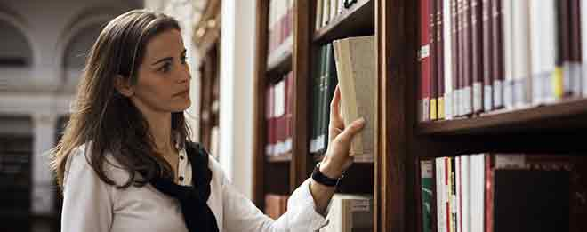 Woman searching for Legal Answers at Law Library